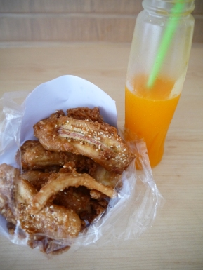Fresh orange juice and deep fried bananas.