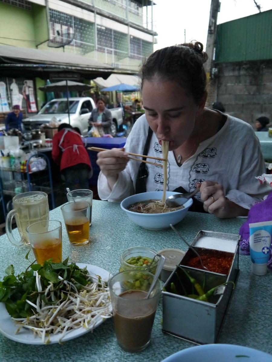 Enjoying noodle soup.